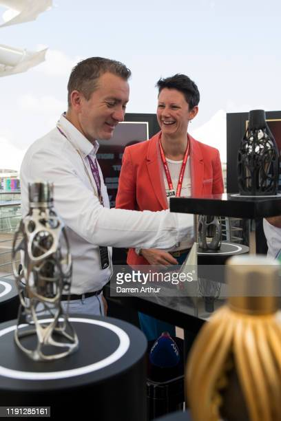 Sky News host Craig Slater and F1 director of marketing and communications Ellie Norman at the launch of the F1 fragrance at the Formula 1 Etihad...