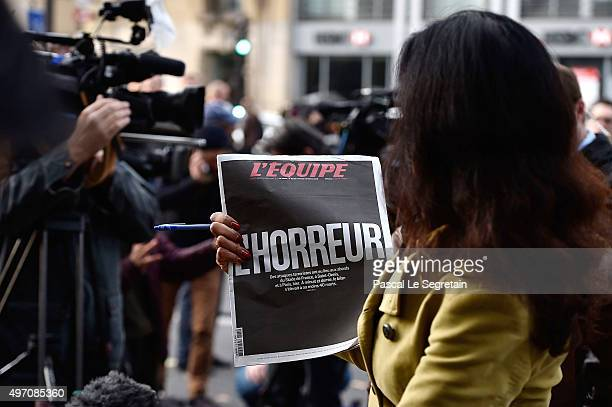 Sky News journalist holds a French newspaper after a terrorist attack on November 14 2015 in Paris France At least 120 people have been killed and...