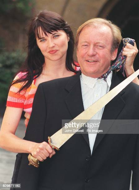 Sky News Sunrise presenter Bob Friend gets a taste of cold steel from Lucy Lawless star of XenaWarrior Princess at the launch of SKY TV's Autumn...