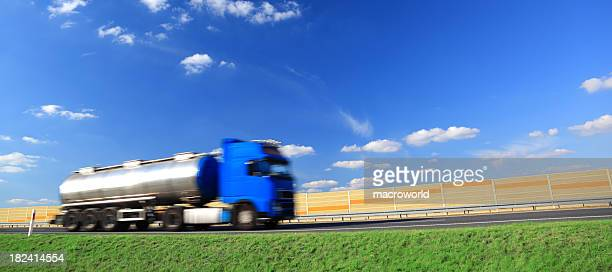 Sky over blue truck on a highway