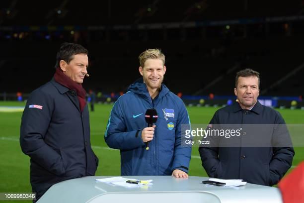 Sky presenter Sebastian Hellmann Arne Maier of Hertha BSC and SKY Sport expert Lothar Matthaeus after the game between Hertha BSC and Eintracht...