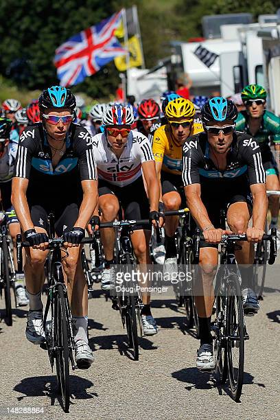 Sky Procycling teammates Christian Knees of Germany Edvald Boasson Hagen of Norway Bradley Wiggins of Great Britain in the race leader's yellow...