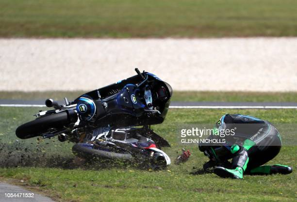 TOPSHOT Sky Racing Team VR46's Italian rider Dennis Foggia crashes during the Australian Grand Prix Moto3 race at Phillip Island circuit on October...