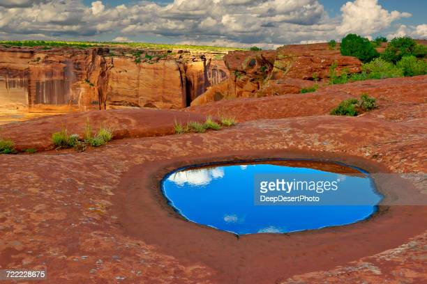 Sky reflected in a puddle, Canyon de Chelly, Arizona, America, USA