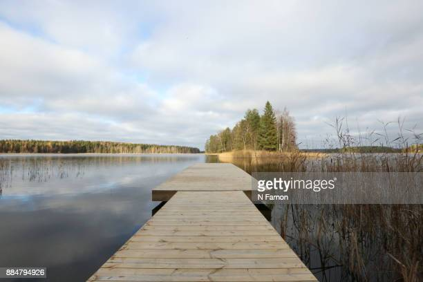 Sky reflected in lake with jetty
