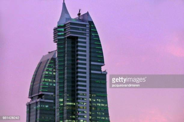 sky scraper in bahrain during sunset - manama stock pictures, royalty-free photos & images