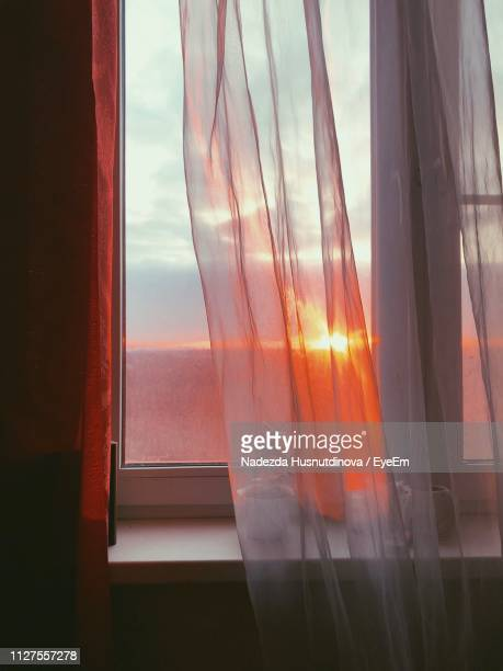 sky seen through window during sunset - photographed through window stock pictures, royalty-free photos & images