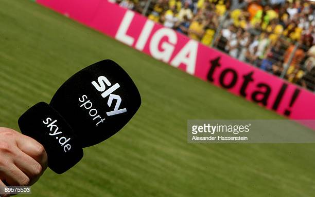 Sky sport TV microphone is seen in front of a Liga total! advertising board during the DFB Cup first round match between SpVgg Weiden and BVB...