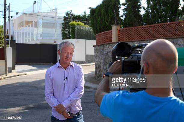 Sky Sports' British reporter Gary Coterill speaks to the camera as he works outside Barcelona's Argentinian forward Lionel Messi's house in Barcelona...