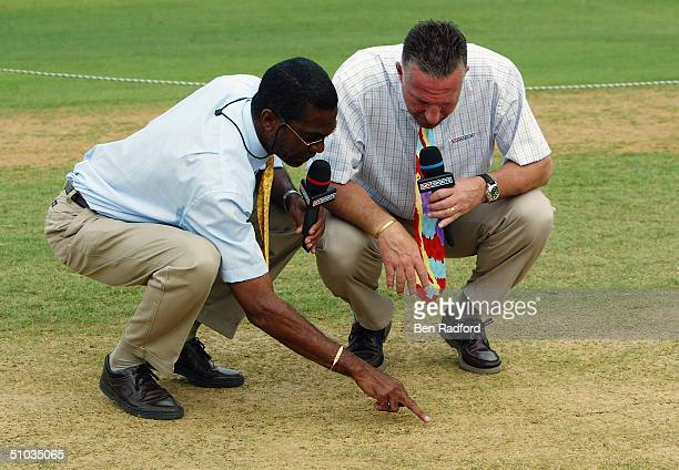 Sky Sports commentators Ian Botham and Michael Holding inspect the pitch before the start of play during the Cable and Wireless First Test match...