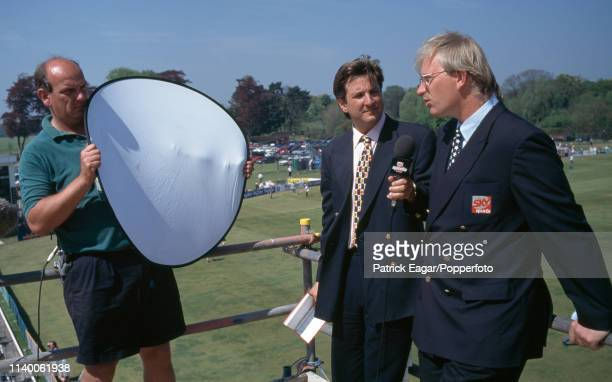 Sky Sports commentators Mark Nicholas and Paul Allott stand on a television camera gantry while discussing the Benson and Hedges Cup Semi Final...