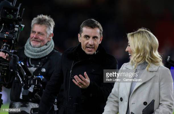 Sky Sports presenter Kelly Cates chats to pundit Gary Neville during the Premier League match between Sheffield United and West Ham United at Bramall...