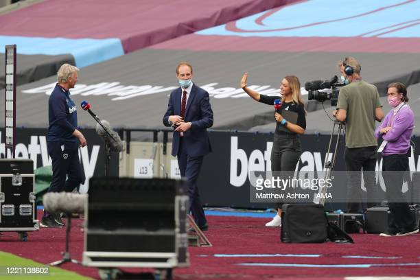Sky Sports presenter Laura Woods keeping socially distant during an interview with West Ham United manager / head coach David Moyes during the...