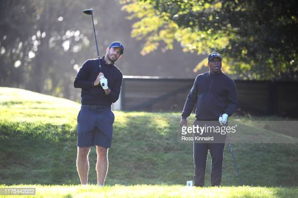 Sky Sports pundit and former English footballer Jamie Redknapp looks on after teeing off during the ProAm tournament prior to the start of the BMW...