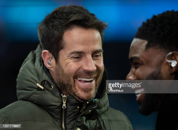 Sky Sports pundit and presenter Jamie Redknapp shares a joke with fellow presenter Micah Richards before the Premier League match between Manchester...