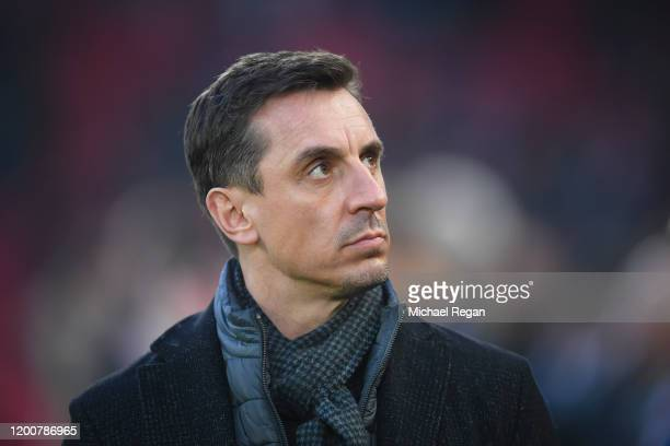 Sky Sports pundit Gary Neville looks on during the Premier League match between Liverpool FC and Manchester United at Anfield on January 19 2020 in...