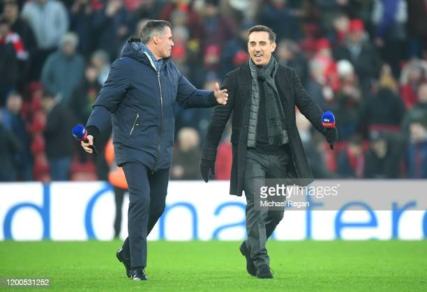 Sky Sports Pundits Gary Neville and Jamie Carragher are seen on the pitch prior to the Premier League match between Liverpool FC and Manchester...