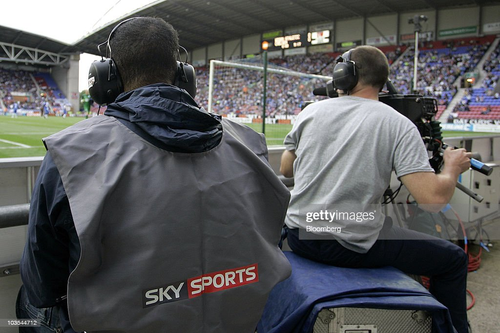 A Sky Sports technician, left, sits with a television camera operator during Sky's 3D coverage of the soccer match at Wigan Athletic Football Club in Wigan, U.K., on Saturday, Aug. 21, 2010. British Sky Broadcasting Group Plc, which rejected News Corp.'s proposed bid for full ownership last month, said annual adjusted operating profit rose 10 percent as more clients signed up for high-definition television service. Photographer: Simon Bellis/Bloomberg via Getty Images