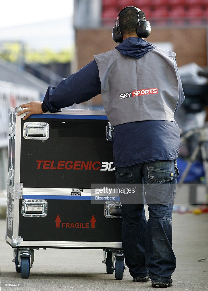 A Sky Sports technician removes television equipment following the game at Wigan Athletic Football Club in Wigan, U.K., on Saturday, Aug. 21, 2010. British Sky Broadcasting Group Plc, which rejected News Corp.'s proposed bid for full ownership last month, said annual adjusted operating profit rose 10 percent as more clients signed up for high-definition television service. Photographer: Simon Bellis/Bloomberg via Getty Images