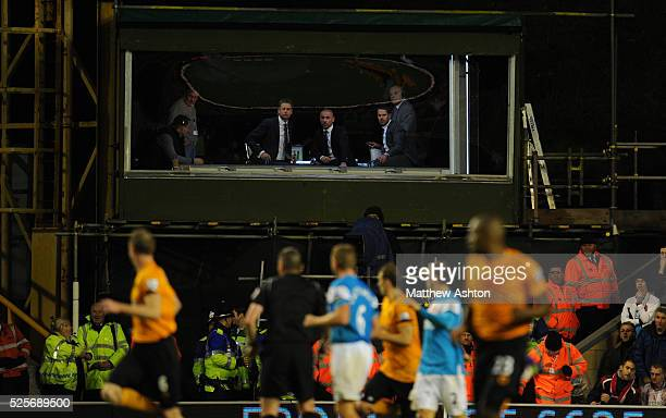 Sky Sports Television presenter Ed Chamberlin and guests Kevin Philips and Jamie Redknapp watch the game from the TV studio