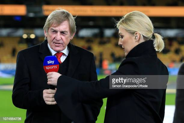 Sky Sports television presenter Kelly Cates hands her father Liverpool legend Kenny Dalglish a microphone before the Premier League match between...