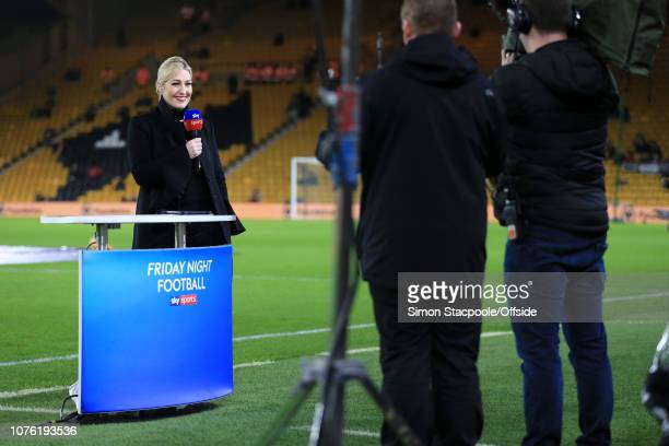 Sky Sports television presenter Kelly Cates holds the microphone ahead of the Premier League match between Wolverhampton Wanderers and Liverpool at...