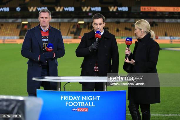 Sky Sports television presenter Kelly Cates speaks to pitchside pundits Gary Neville and Jamie Carragher before the Premier League match between...