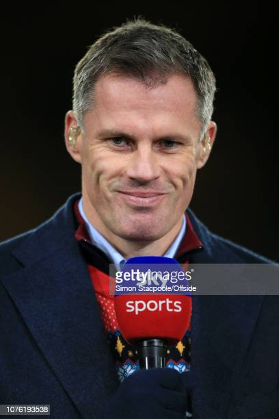 Sky Sports television pundit Jamie Carragher holds the microphone ahead of the Premier League match between Wolverhampton Wanderers and Liverpool at...