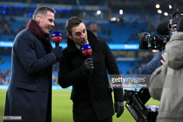Sky Sports television pundits Jamie Carragher and Gary Neville joke in front of the camera during the Premier League match between Manchester City...