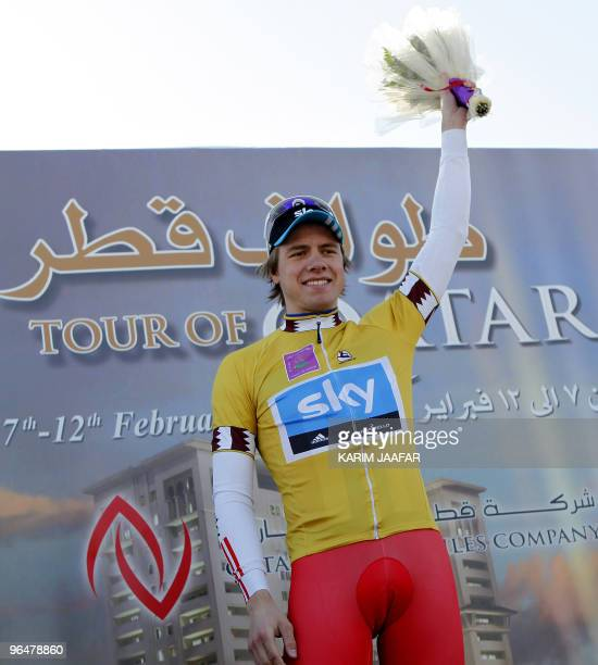 Sky team rider Edvald Boasson Hagen of Norway poses on the podium with his gold jersey after winning the first stage of the Tour of Qatar cycling...