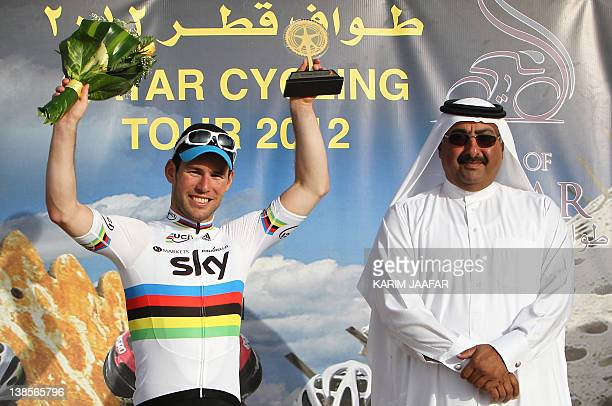 Sky Team rider Mark Cavendish of Great Britain celebrates on the podium next to Sheikh Khaled bin Ali al-Thani, president of the Qatar Cycling...