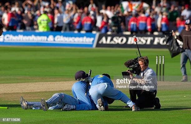 A Sky TV cameraman moves in for a closeup as India players celebrate winning the NatWest Series Final between England and India at Lord's Cricket...