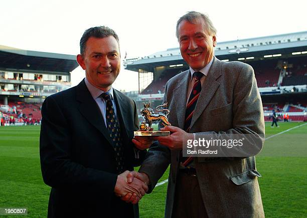 Sky TV Commentator Martin Tyler receives the award for Premiership Commentator of the Decade from Richard Scudamore before the FA Barclaycard...