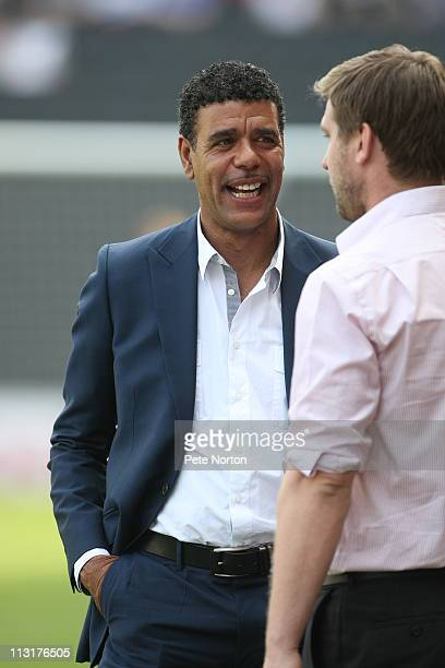 Sky TV pundit Chris Kamara talks to MK Dons manager Karl Robinson prior to the npower League One match between MK Dons and Huddersfield Town at...