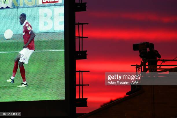 Sky TV / Television Cameraman against the sunset at The City Ground home of Nottingham Forest during the Sky Bet Championship match between...
