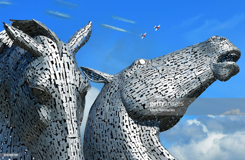 Sky writing aircraft perform acrobatics for Queen Elizabeth II and Prince Philip, Duke of Edinburgh above the Kelpies on July 5, 2017 in Falkirk, Scotland. Queen Elizabeth II and Prince Philip, Duke of Edinburgh visited the new section the Queen Elizabeth II Canal, built as part of the £43m Helix project which features the internationally-acclaimed, 30-metre-high Kelpies sculptures.