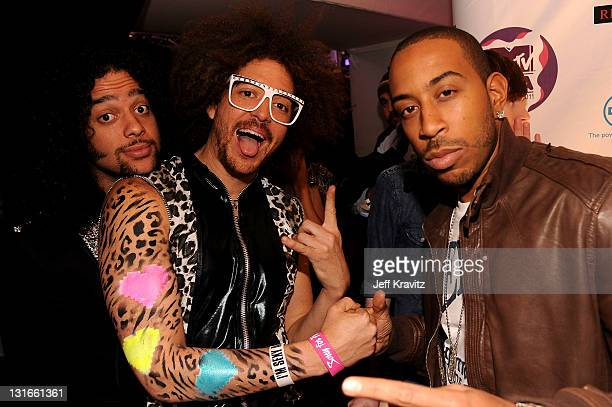 SkyBlu and Redfoo of LMFAO pose with Ludacris backstage during the MTV Europe Music Awards 2011 live show at the Odyssey Arena on November 6 2011 in...