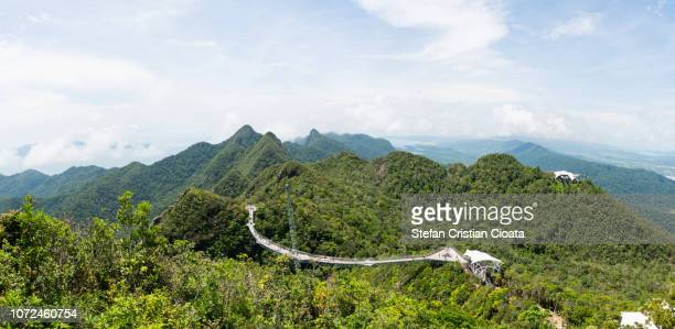 skybridge over tropical forest in langkawi island (pulau langkawi), malaysia - elevated walkway stock pictures, royalty-free photos & images
