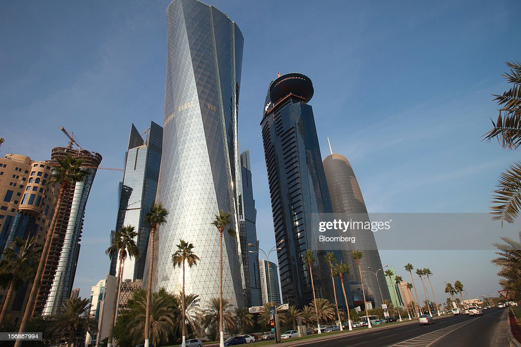 Skycrapers stand beside a highway on the city skyline in Doha, Qatar, on Thursday, Nov. 22, 2012. Qatar Telecom QSC, the country's biggest company by revenue, is seeking a syndicated loan for about $1 billion to refinance existing debt, according to a person with direct knowledge of the deal. Photographer: Gabriela Maj/Bloomberg via Getty Images