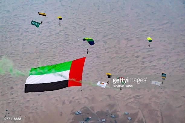 Skydive Dubai's David Junior Ludvik skydives with a 4886square meter flag over Skydive Dubai's Desert Campus dropzone in Dubai United Arab Emirates...