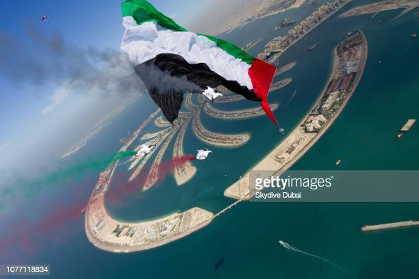 Skydive Dubai's demonstration team which included wingsuits skydives with the Guinness World Record flag over the manmade island the Palm Jumeirah...