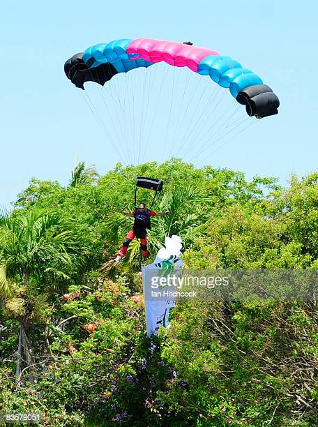 A skydiver displaying the new name and logo of the North Queensland Fury hits a tree before landing before the start of a press conference announcing...