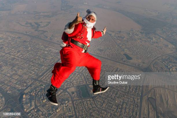 A skydiver dressed as Santa Claus is captured in freefall above Dubai United Arab Emirates on December 20 2018 in Dubai United Arab Emirates