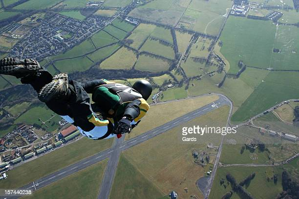 Skydiver free falling above countryside