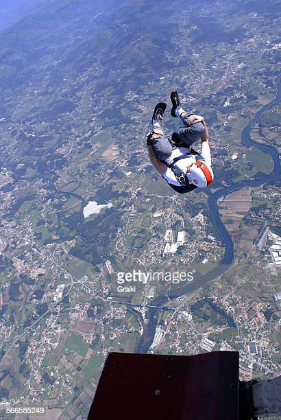 Skydiver front looping exit