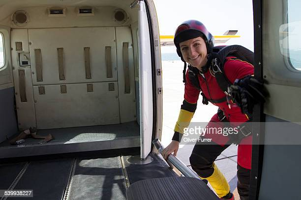 Skydiver girl is entering the plane at Dubai city