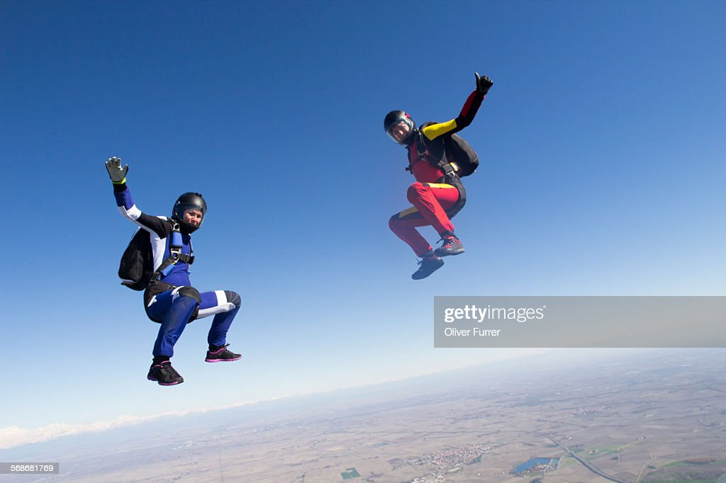 Skydiver girls team are flying high in the sky.\ : Stock Photo
