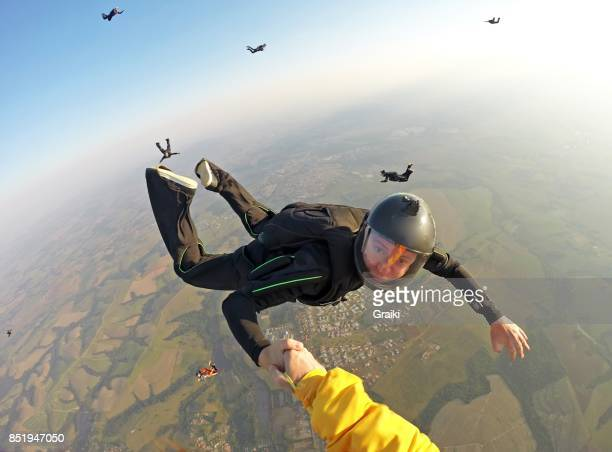 skydiver handshake - point of view stock pictures, royalty-free photos & images