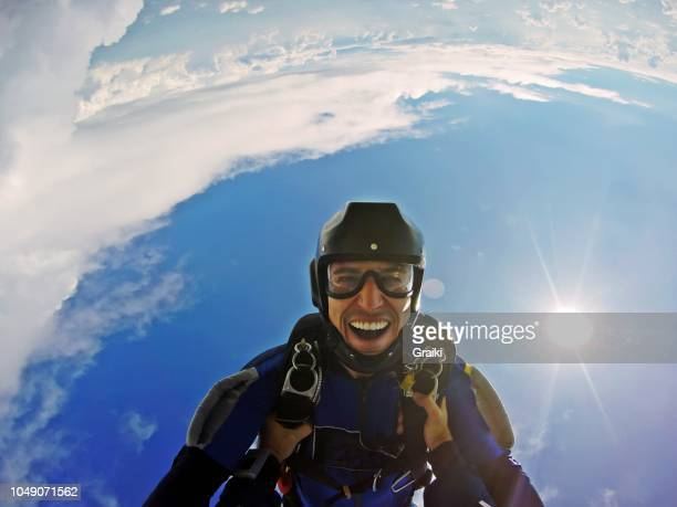 skydiver having fun in free fall. point of view jump - スカイダイビング ストックフォトと画像