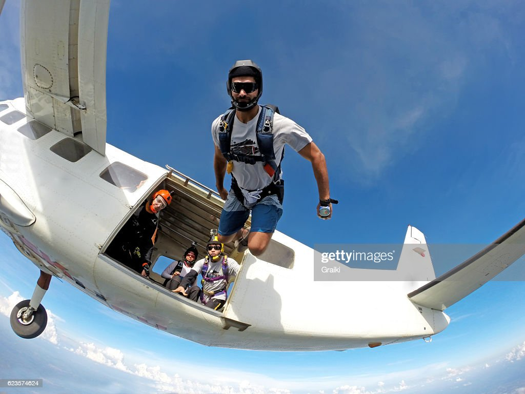 Skydiver jumping out of plane : Stock Photo